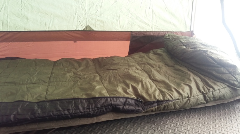 My Slumberjack Everest (ha) Elite sleeping bag, atop a kick-ass thick mattress pad, atop foam exercise flooring (because there's no such thing as too much cushion when tent camping).